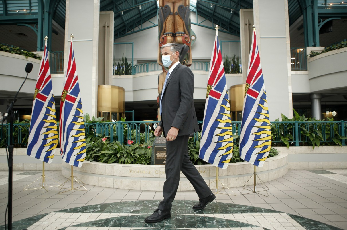 Liberal Leader Andrew Wilkinson wears a mask as her prepares to make an address at the UBCM.